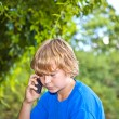 Young boy talking on a cell phone. — Stock Photo #8372914