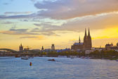 Sunset in cologne with Dome and river Rhine — Stock Photo
