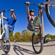 Stock Photo: Boys show double wheely with bike