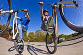 Boys show double wheely with the bike — Stock Photo