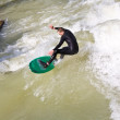 Surfing on river ISAR in Munich, Germany. — Stock Photo #8593151