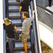On moving staircase in modern shopping center in Frankfurt — Stock Photo #8593699