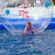 Girls and boys have fun in a huge zorbing ball — ストック写真