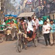Cycle rickshaw driver with passenger in Chawri Bazar, Delhi earl — Stock Photo