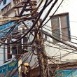 Electricity distribution in Chawri Bazaar in Old Delhi - Stock Photo