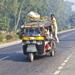 Stock Photo: In overloaded cars on Highway between Delhi and Agra