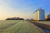 Silos in the middle of a field in wintertime — Stock Photo