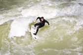 Surfing on river ISAR in Munich, Germany. — Stok fotoğraf