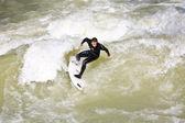 Surfing on river ISAR in Munich, Germany. — Stok fotoğraf