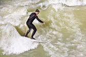 Surfing on river ISAR in Munich, Germany. — Stock Photo