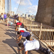 Exercise push-up at Brooklyn bridge - Stock Photo