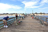 Enjoy fishing at the famous pier — Stock Photo