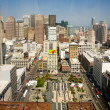 Skyline of San Francisco seen from a sky scraper with blue sky - Stock Photo