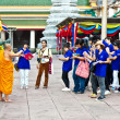 Постер, плакат: Buddhist monk explains the secrets of temple area Wat Pho