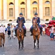 Stock Photo: Police on horses are watching and helping spectators enterin