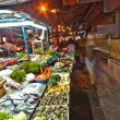 Fresh fish and vegetables  offered at the night market - Stock Photo