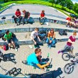 Boys at a skate Park watching other bikers and having fun — Stock Photo