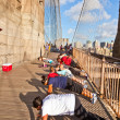 Push-up at Brooklyn Bridge in New York - Stock Photo