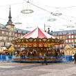 Carousell for children in the evening at the plaza de Mayor in M - Stock Photo