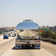 Reflection of a car in a chrome truck transporting liquids - Stok fotoğraf