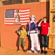 Family is posing  with a picture of John Wayne at John Fords pla - Stock Photo