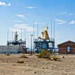 19: Radar station in the desert near the old ghost town and the — Stock Photo