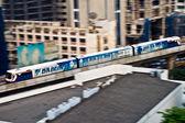 Sky Train in motion between station NANA and ASHOKA — Stock Photo
