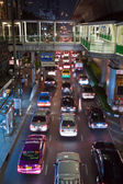 Main road in Bangkok in nightly traffic jam with cars — Stock Photo