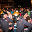 Police tries to calm down demonstrants - vendors of Patpong Nigh - Stock Photo