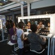 Cosmetic company AMWAY sponsores a makeup course - Foto Stock
