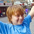 Smart boy enjoys walking in the pedestrian zone - Stok fotoğraf
