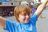 Smart boy enjoys walking in the pedestrian zone — Stock Photo