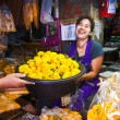 Stock Photo: Women are selling fresh flowers at morning market
