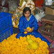 Women are selling fresh flowers at the morning market - Stock Photo