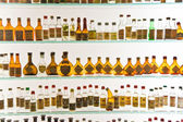 Old Grappa bottles in Basano de Grappa in a Grappa Museum — Stock Photo