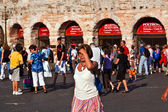 Visitors, spectators are taking a photo outside the arena di ver — Stock Photo