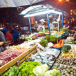 Fresh fish and vegetables  offered at the night market in Sukhum — Stock Photo