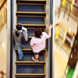 Woman using the moving staircase in the shopping center Central in Bangkok - Zdjęcie stockowe