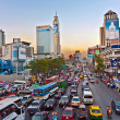 Main road in Bangkok in afternoon traffic jam near the CENTRAL s — Stock Photo #8832796