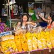 Selling flowers at Pak Khlong Thalat market - Stock Photo