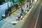 Wait for the next bus at Sukhumvit road — Stock Photo