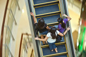 Woman using the moving staircase in the shopping center Central in Bangkok — Stock Photo