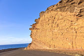 Volcanic stone formation with blue sky at el Golfo, Lanzarote — Stock Photo