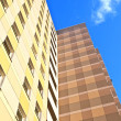 Facade of skyscraper with apartments with blue sky — Stock Photo #8865378