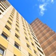 Facade of skyscraper with apartments with blue sky — Stock Photo #8865427