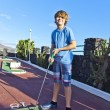 Boy playing mini golf in the course — Stock Photo #8891564