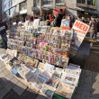 Newspapers sold in front of Stephans dome in vienna - Stock Photo
