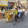 Rickshaw rider transports passenger — Stock Photo #8895031