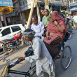 Rickshaw rider transports passenger — Stock Photo #8895331