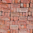 Red stapled bricks give harmonic pattern in sun — Stock Photo #8899220